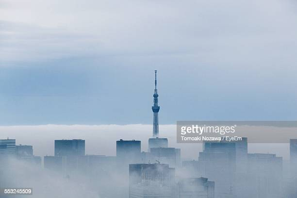 Tokyo Sky Tree And Buildings Covered In Clouds