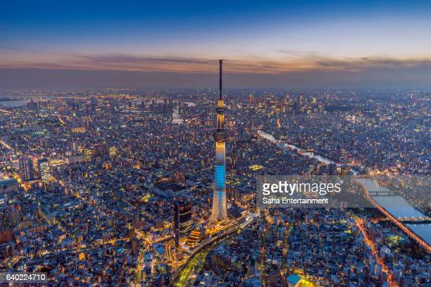 tokyo sky tree light up aerial shot at dusk - saha entertainment stock pictures, royalty-free photos & images