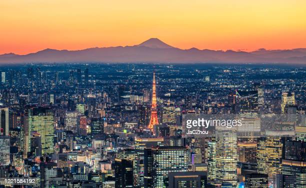 tokyo skyline at dusk with mt.fuji background - tokyo japan stock pictures, royalty-free photos & images