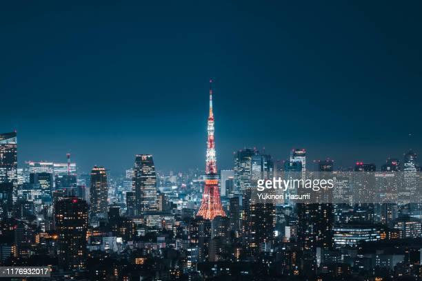 tokyo skyline at night - 塔 ストックフォトと画像
