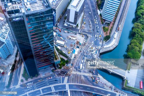 tokyo skyline elevated view at waterfront with skyscrapers, office buildings, tokyo bay, 2018 olympic venues, tokyo, japan. - olympic stadium stock pictures, royalty-free photos & images