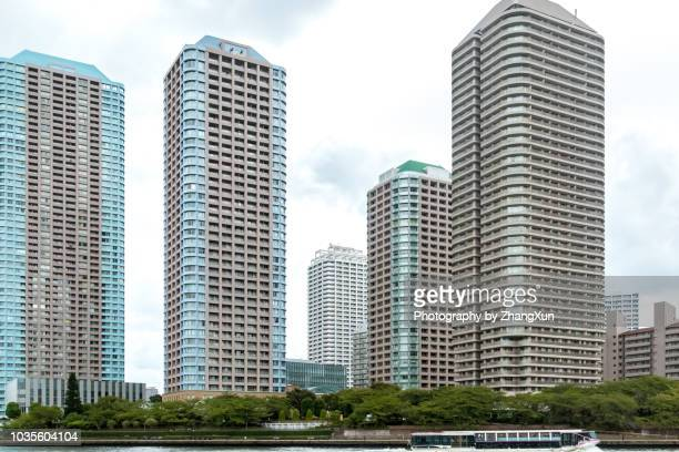 Tokyo Skyline over the Sumida River with residential and office buildings at day time, Chuo ward, Tokyo, Japan.