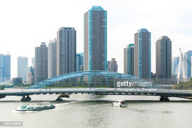 tokyo skyline waterfront landscape in koto, chuo ward, tsukishima area japan at day time. - 永代橋 ストックフォトと画像