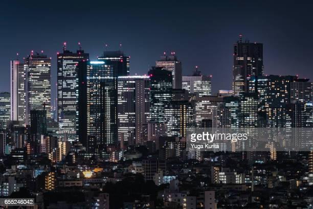 tokyo skyscrapers at night - 商業地域 ストックフォトと画像