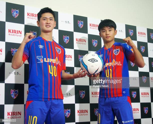 FC Tokyo soccer players Takefusa Kubo and Rei Hirakawa pose for photos during a press conference in Tokyo on Nov 1 after the club announced that the...
