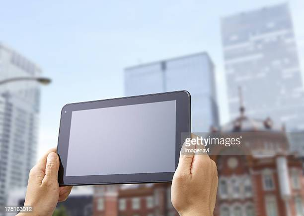 Tokyo Station and a tablet PC