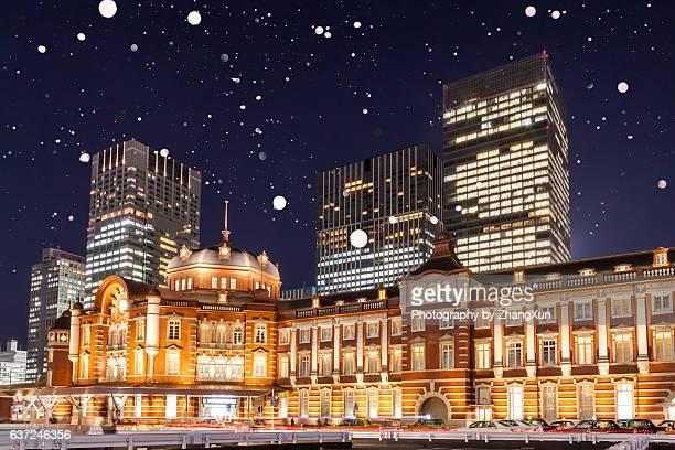 Tokyo station illuminated with snow at night, Ootemachi, Marunouchi, Japan.