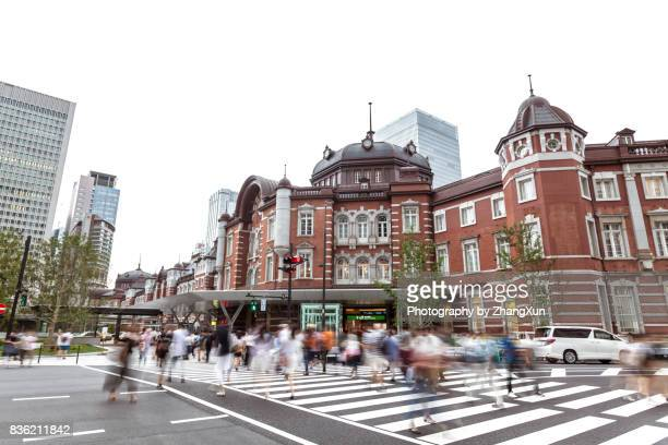 Tokyo station intersection skyline at day time with busy traffics, Japan.