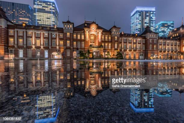 tokyo station light up reflect puddle - saha entertainment stock pictures, royalty-free photos & images