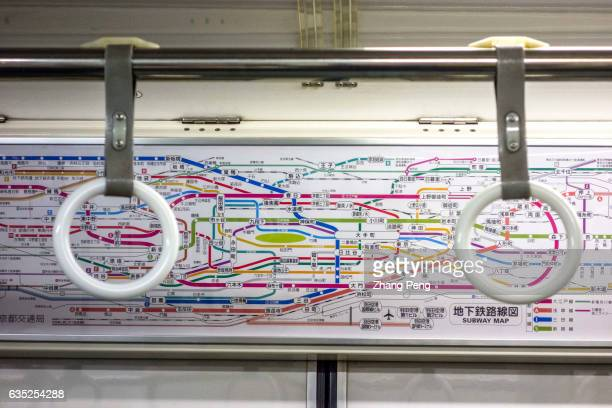 Tokyo subway route map in the carriage The Tokyo subway is the most dense network and the crowded public transportation system not only in Japan but...