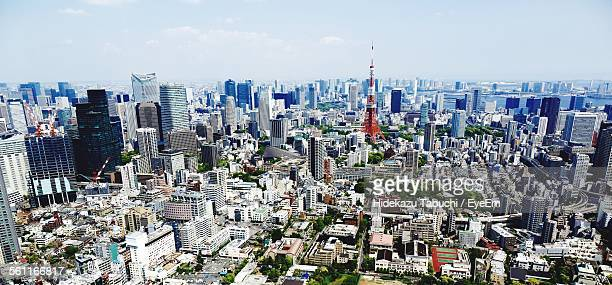 Tokyo Tower Amidst Buildings In City Against Sky