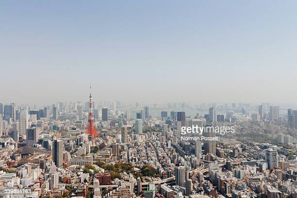 Tokyo Tower amidst cityscape against clear sky