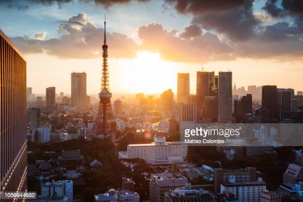 tokyo tower and city at sunset. tokyo, japan - roppongi hills stock pictures, royalty-free photos & images