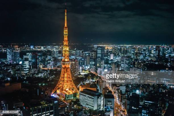tokyo tower at night seen from roppongi hills - vadim krisyan stock pictures, royalty-free photos & images