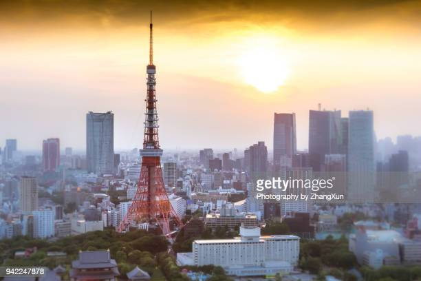 tokyo tower bokeh image at sunset, tokyo, japan. - townscape stock pictures, royalty-free photos & images