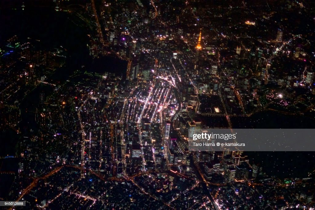 Tokyo Tower, Ginza and Tokyo station in Japan night time aerial view from airplane : Stock Photo