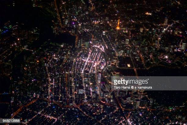 tokyo tower, ginza and tokyo station in japan night time aerial view from airplane - kanto region stock pictures, royalty-free photos & images