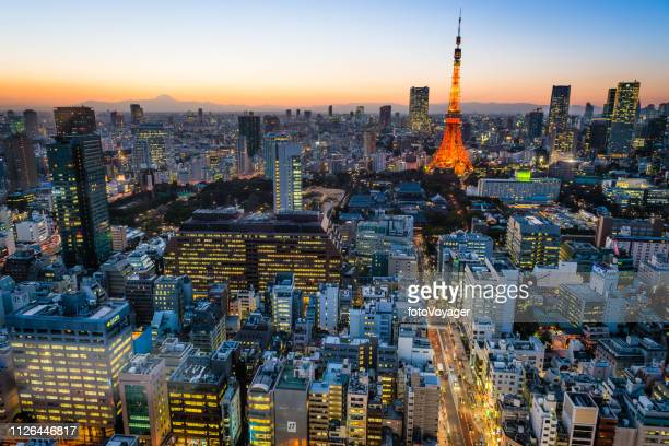tokyo tower sunset aerial view over crowded cityscape lights japan - roppongi hills stock pictures, royalty-free photos & images