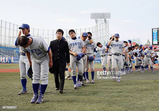 Tokyo University baseball team members show their dejections after losing to Waseda University during the Spring League of the Tokyo Big 6 Baseball...