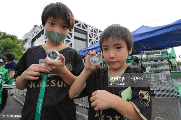 Tokyo Verdy supporters are seen outside the stadium prior to the J.League Meiji Yasuda J2 match between Tokyo Verdy and Giravanz Kitakyushu at...