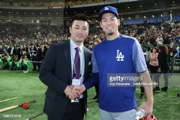 Tokyo Yakult Swallows player Norichika Aoki and Pitcher Kenta Maeda of the Los Angeles Dodgers pose for photographs prior to the game three of Japan...