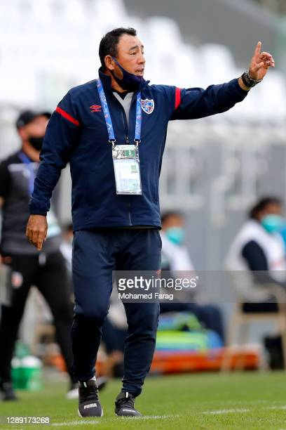 Tokyo's coach Kenta Hasegawa speaks to his players during the AFC Champions League Group F match between Perth Glory and FC Tokyo at the Education...