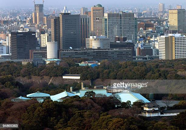 Tokyo's Imperial Palace foreground is surrounded by trees while the city of Tokyo Japan stretaches on to the horizon March 19 2004