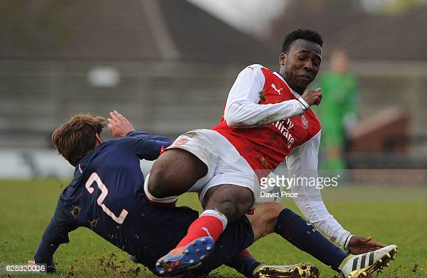 Tolaji Bola of Arsenal challenges Alexis Giacomini of PSG during the UEFA Youth League match between Arsenal and Paris Saint Germain at Meadow Park...