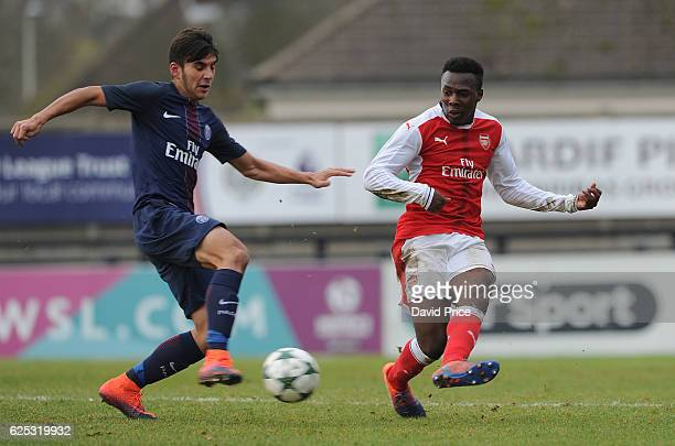 Tolaji Bola of Arsenal closed down by Metehan Guclu of PSG during the UEFA Youth League match between Arsenal and Paris Saint Germain at Meadow Park...