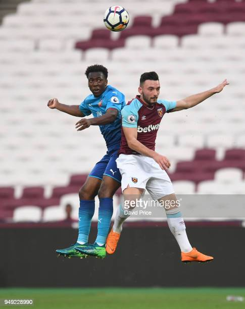 Tolaji Bola of Arsenal heads the ball under pressure from Sead Haksabanovic of West Ham during the match between West Ham United and Arsenal at...