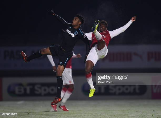 Tolaji Bola of Arsenal is challenged by Jahmal HectorIngram of West Ham during the Premier League Two match between Arsenal U23 and West Ham United...