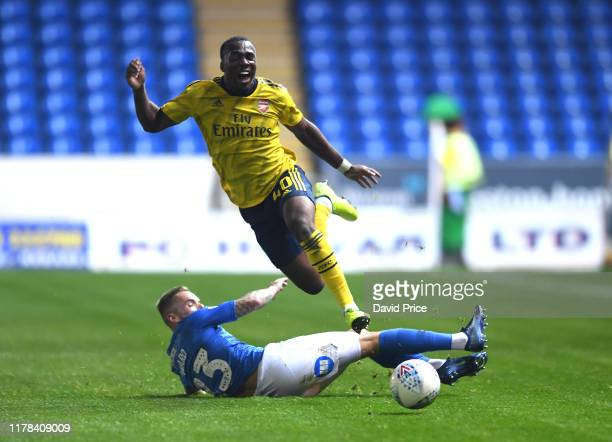 Tolaji Bola of Arsenal is fouled by Joe Ward of Peterborough during the Leasing.com Cup match between Peterborough United and Arsenal U21 at Weston...