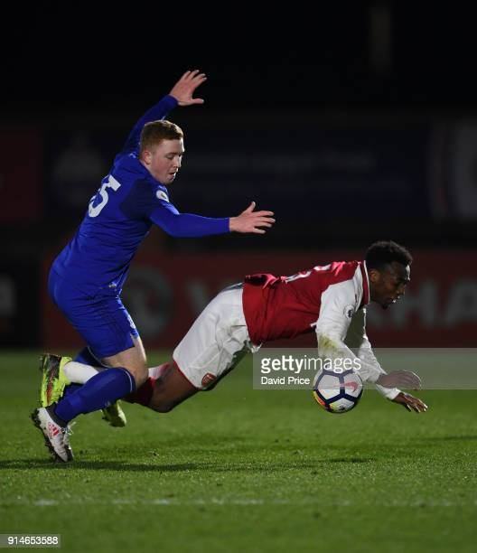 Tolaji Bola of Arsenal is fouled by Shayne Lavery of Everton during the Premier League 2 match between Arsenal and Everton at Meadow Park on February...