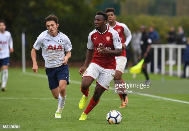 Tolaji Bola of Arsenal takes on George Marsh of Tottenham during the match between Tottehma Hotspur and Arsenal on October 23 2017 in Enfield England