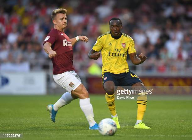 Tolaji Bola of Arsenal takes on Sam Hoskins of Northampton during the Leasingcom match between Northampton Town and Arsenal U21 at PTS Academy...