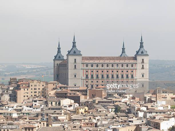 Toledo Alcazar Castle on the top of the Old Town. Toledo was declared a World Heritage Site by UNESCO in 1986 based on its extensive cultural and...
