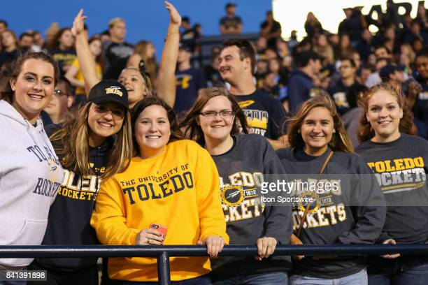 Toledo fans cheer during the first half of game action between the Elon Phoenix and the Toledo Rockets on August 31 at the Glass Bowl in Toledo OH