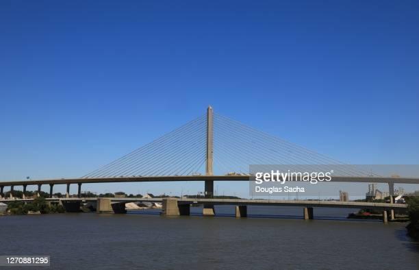 toledo glass city skyway bridge and the robert craig bridge over the maumee river - toledo ohio stock pictures, royalty-free photos & images