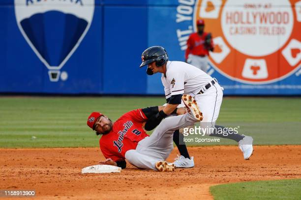Toledo Mud Hens left fielder Danny Woodrow runs over Louisville Bats second baseman Alex Blandino while trying to steal second base during a regular...