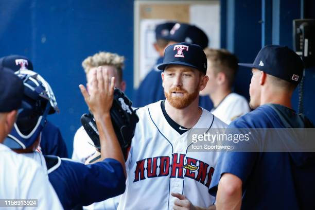 Toledo Mud Hens starting pitcher Spencer Turnbull receives congratulations from his teammates in the dugout after being relieved during a regular...