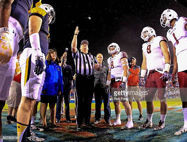 Toledo Rockets and Temple Owls players line up for the coin toss before the game at FAU Stadium on December 22, 2015 in Boca Raton, Florida.