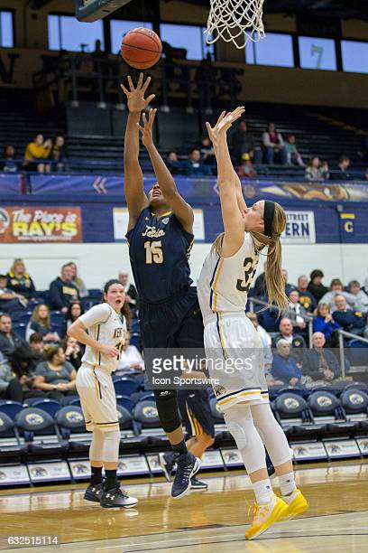 Toledo Rockets C Kaayla McIntyre shoots as Kent State Golden Flashes F Jordan Korinek defends during the second quarter of the NCAA Women's...