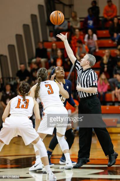 Toledo Rockets center Kaayla McIntyre and Bowling Green Falcons guard Andrea Cecil watch the ball being throw into the air by an referee Tom Hallead...