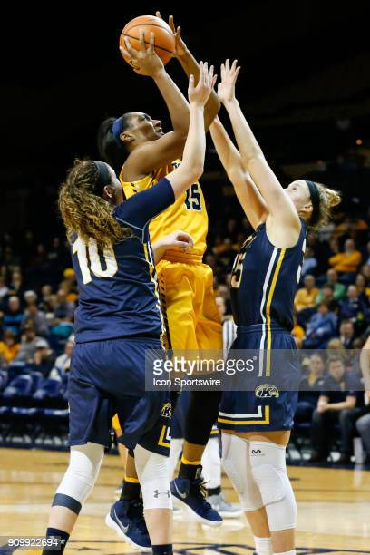 Toledo Rockets center Kaayla McIntyre shoots over Kent State Golden Flashes forward Jordan Korinek and Kent State Golden Flashes forward McKenna...