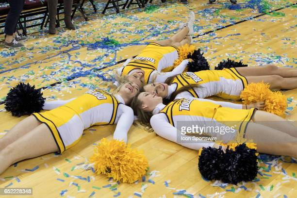 Toledo Rockets cheerleaders celebrate on the court following the MAC tournament championship game between the Northern Illinois Huskies and Toledo...