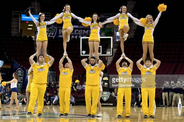 Toledo Rockets cheerleaders perform during the third quarter of the MAC womens basketball tournament championship game between the Northern Illinois...