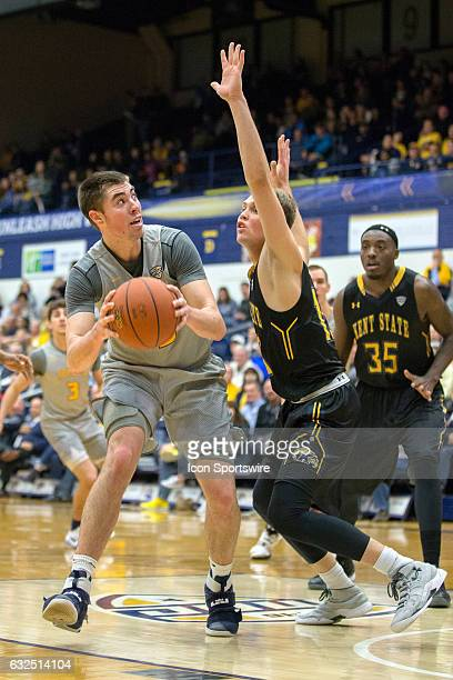 Toledo Rockets F Nate Navigato looks to shoot as Kent State Golden Flashes G Mitch Peterson defends during the second half of the NCAA Men's...