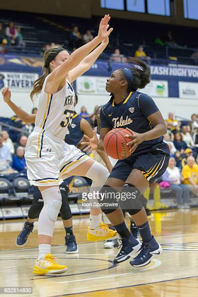 Toledo Rockets F Sarah StFort is defended by Kent State Golden Flashes F Jordan Korinek during the second quarter of the NCAA Women's Basketball game...