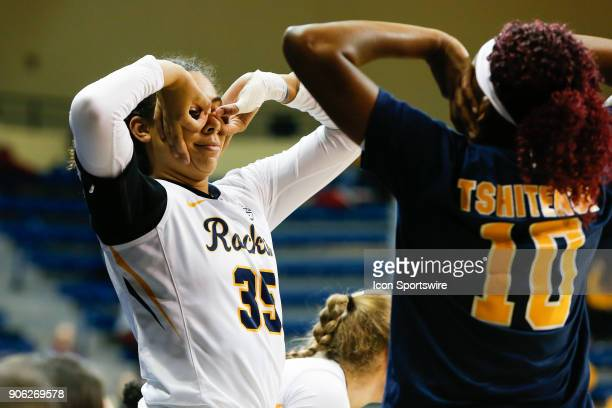 Toledo Rockets forward Jada Woody and Toledo Rockets forward Merveilles Tshitenge celebrate a threepoint shot during the first half of a regular...