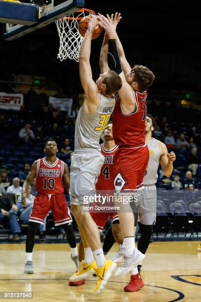 Toledo Rockets forward Luke Knapke and Northern Illinois Huskies forward Noah McCarty battle to grab a rebound during the first half of a regular...
